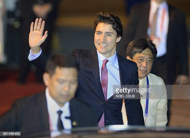 Canada's Prime Minister Justin Trudeau waves upon his arrival at the airport to attend the AsiaPacific Economic Cooperation Summit in Manila on...