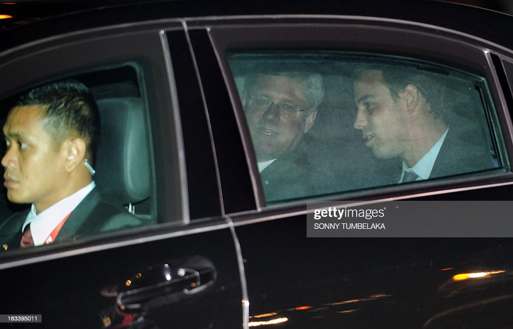 Canada's Prime Minister Stephen Harper (C) drives off after his arrival at Ngurah Rai International Airport in Denpasar on the Indonesian resort island of Bali to take part in the Asia-Pacific Economic Cooperation (APEC) summit on October 6, 2013. Leaders of the 21-member APEC grouping are arriving in Bali ahead of the leader's summit on October 7-8 in nearby Nusa Dua.