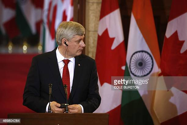 Canada's Prime Minister Stephen Harper takes part in a joint press conference alongside India's Prime Minister Narendra Modi Parliament Hill in...