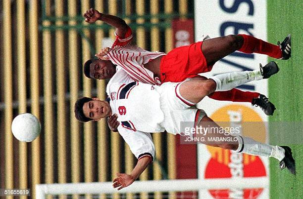 Canada's Randy Samuel and David Wagner of the US struggle for the ball during their World Cup qualifying match 16 March at Stanford University The US...
