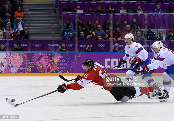 Canada's Rick Nash falls as he tries to score during the Men's Ice Hockey Group B match between Canada and Norway at the Sochi Winter Olympics on...