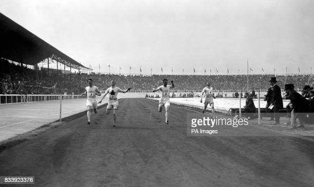 Canada's Robert Kerr runs over the line to win the gold medal in the 200m final The silver medal went to USA's Robert Cloughen and the bronze to...