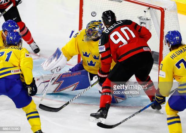 Canada's Ryan O' Reilly scores past Sweden's goalie Henrik Lundqvist during the IIHF Men's World Championship Ice Hockey final match between Canada...