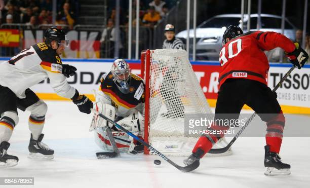 Canada's Ryan O'Reilly and Germany's goalkeeper Philipp Grubauer vie during the IIHF Men's World Championship Ice Hockey quarterfinal match between...