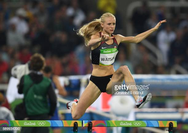 Canada's Sage Watson competes in the Women's 400m Hurdles Round 1 during the athletics event at the Rio 2016 Olympic Games at the Olympic Stadium in...