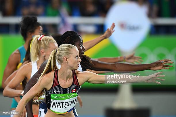 Canada's Sage Watson prepares to receive the baton in the Women's 4x400m Relay Final during the athletics event at the Rio 2016 Olympic Games at the...