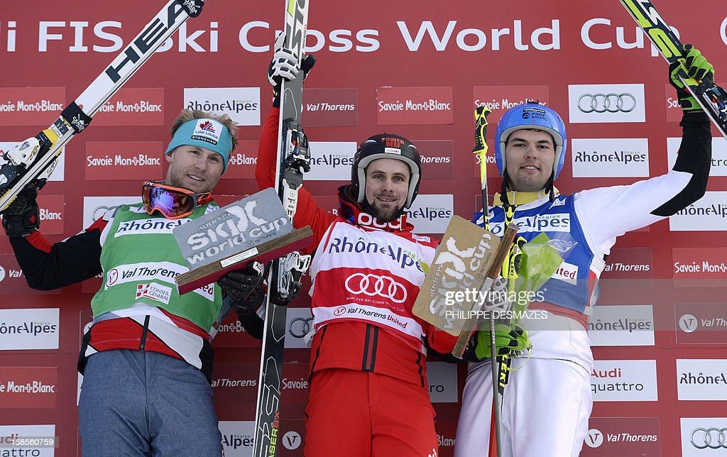 Canada's silver medalist Leman Brady, Switzerland's gold medalist Armin Niederer, and US bronze medalist Joe Swensson (R) pose on the podium the FIS men's World Cup Skicross at the Val Thorens ski resort, French Alps, on December 19, 2012.