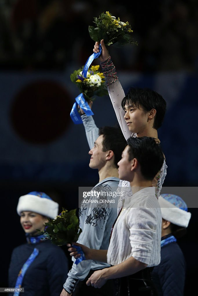 Canada's silver medalist Patrick Chan (L), Japan's gold medalist Yuzuru Hanyu and Kazakhstan's bronze medalist Denis Ten pose on the podium during the Men's Figure Skating Flower Ceremony at the Iceberg Skating Palace during the Sochi Winter Olympics on February 14, 2014.