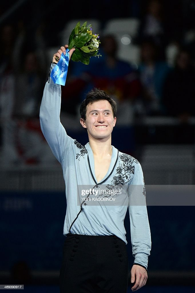 Canada's silver medalist Patrick Chan poses on the podium during the Men's Figure Skating Flower Ceremony at the Iceberg Skating Palace during the Sochi Winter Olympics on February 14, 2014.