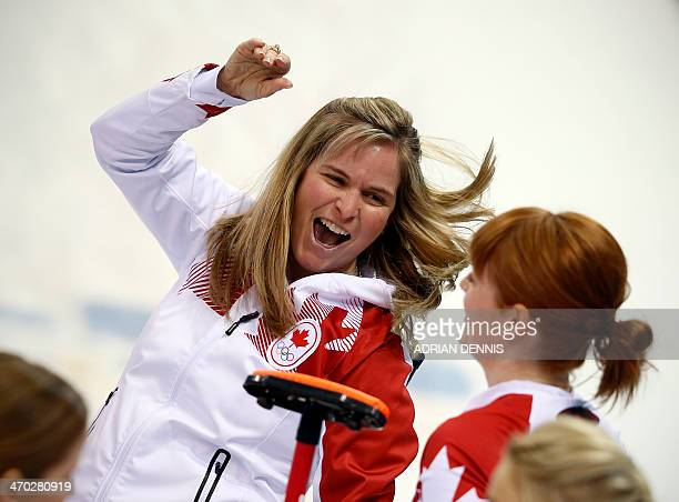 Canada's Skip Jennifer Jones celebrates after throwing the last stone to win the game during the women's semifinal match between Great Britain and...