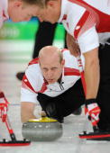 Canada's skip Kevin Martin throws a stone during the men's curling round robin match against Denmark at the Vancouver Olympic Centre during the...