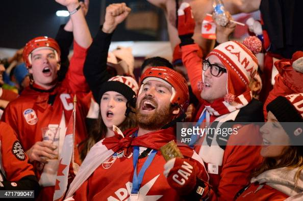 Canada's supporters celebrate outside the Bolshoy Ice Dome after Canada won the Men's Ice Hockey Semifinal match against the USA during the Sochi...