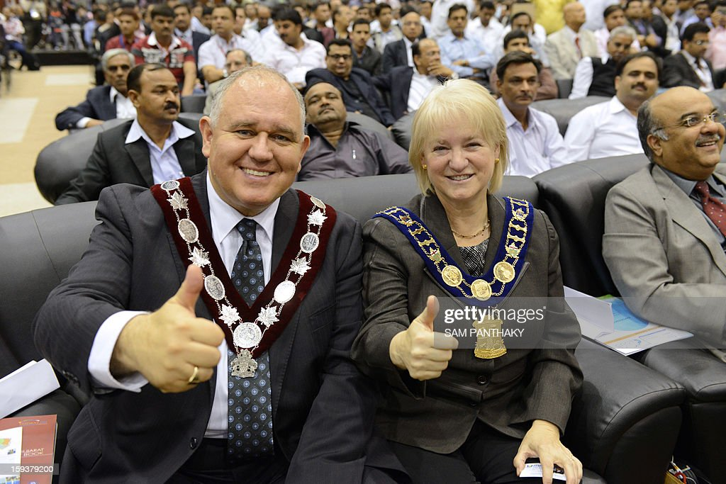 Canada's Susan Fennell, the Mayor of Brampton (2nd L) and Frank Scarpitti, the Mayor of Markham (L) attend the Velidictory function of the Vibrant Gujarat 2013 6th Global Summit at Mahatma Mandir in Gandhinagar, some 30 kms from Ahmedabad on January 12, 2013. The summit was inaugurated by Gujarat Chief Minister, Narendra Modi yesterday and the two day summit is attended by a wide range of national and international corporate representatives. AFP PHOTO / Sam PANTHAKY
