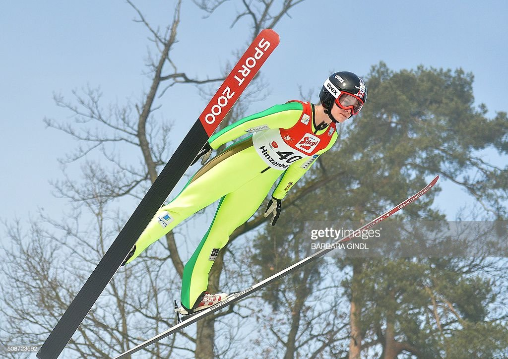 Canada's Taylor Henrich jumps during the qualifying round of the women's ski jumping world cup in Hinzenbach, Upper Austria, on February 6, 2016. / AFP / APA / BARBARA GINDL / Austria OUT
