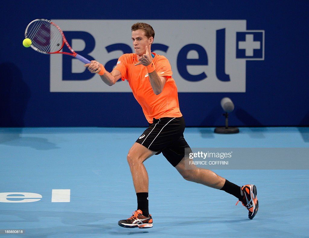 Canada's tennis player Vasek Pospisil returns a ball to Croatia's Ivan Dodig during their quarter-final tennis match at the Swiss Indoors ATP tournament in Basel on October 25, 2013.