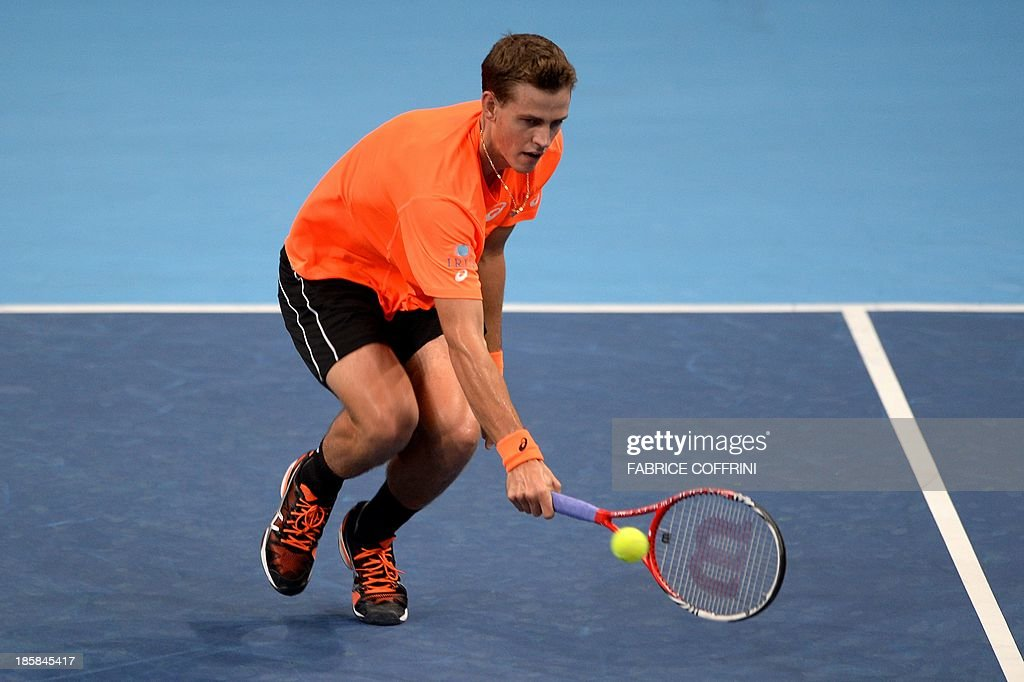 Canada's tennis player Vasek Pospisil returns the ball to Croatia's Ivan Dodig during their quarter-final tennis match at the Swiss Indoors ATP tournament in Basel on October 25, 2013. AFP PHOTO / FABRICE COFFRINI