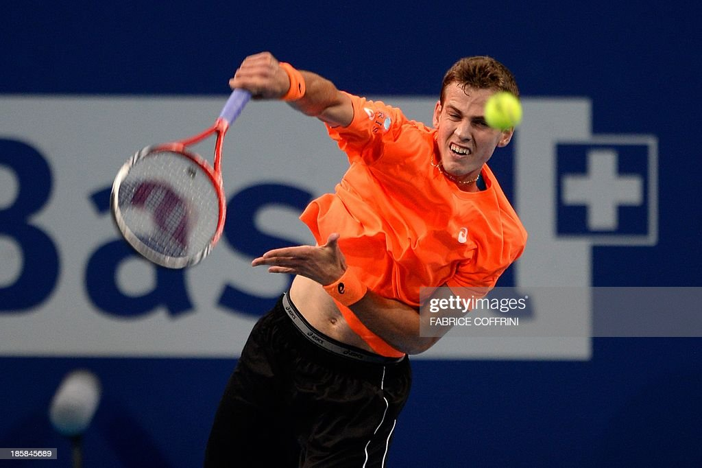 Canada's tennis player Vasek Pospisil serves to Croatia's Ivan Dodig during their quarter-final tennis match at the Swiss Indoors ATP tournament in Basel on October 25, 2013. AFP PHOTO / FABRICE COFFRINI