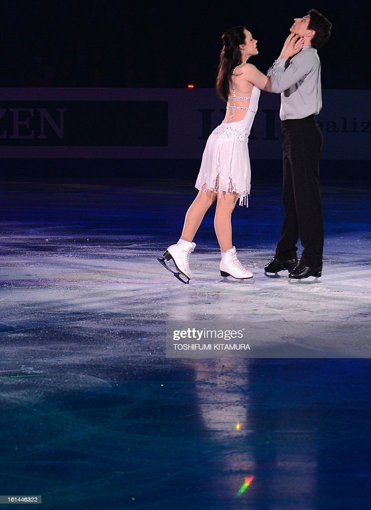 Canada's Tessa Virtue and Scott Moir perform their ice dance routine in the gala exhibition event after the Four Continents figure skating championships in Osaka on February 11, 2013. AFP PHOTO / TOSHIFUMI KITAMURA
