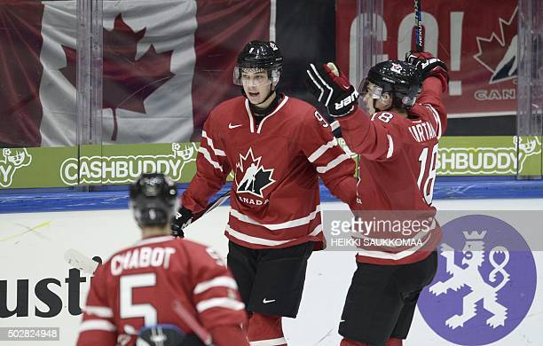 Canada's Thomas Chabot Dylan Strome and Jake Virtanen celebrate Strome's 21 goal during the 2016 IIHF World Junior U20 Ice Hockey Championships...