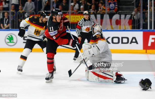 Canada's Travis Konecny and Germany's goalkeeper Torwart Philipp Grubauer vie during the IIHF Men's World Championship Ice Hockey quarterfinal match...