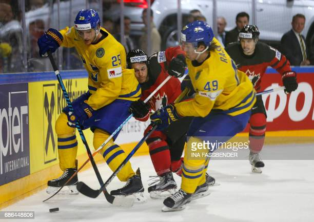 Canada's Travis Konecny vies with Sweden's Jonas Brodin and Sweden's Victor Rask during the IIHF Men's World Championship Ice Hockey final game match...