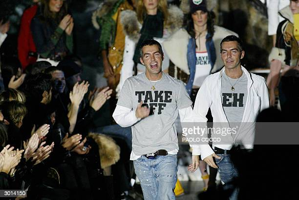 Canada's twins designers Dean and Dan Caten acknowledge applauses on the catwalk at the end of Dsquared2's Autumn/Winter 20042005 women's collection...