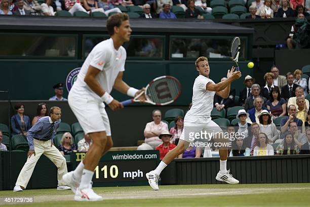 Canada's Vasek Pospisil and Jack Sock play a shot against US players Bob and Mike Bryan during their men's doubles final match on day twelve of the...