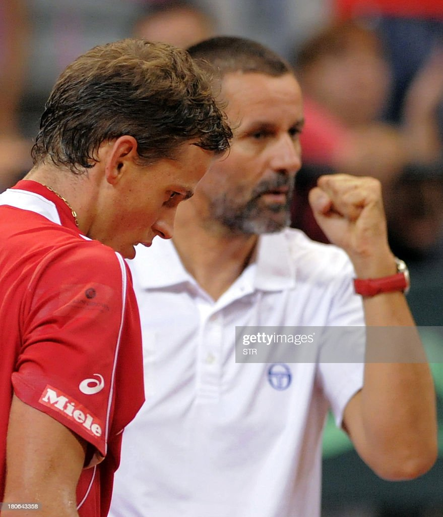 Canada's Vasek Pospisil (L) reacts with disappointment after losing to Serbia's Janko Tipsarevic at the end of the Davis Cup semi-final match at Belgrade Arena on September 15, 2013. Serbia, the 2010 champions, will host the November 15-17 final against the Czechs who defeated Argentina 3-2 in their semi-final in Prague.