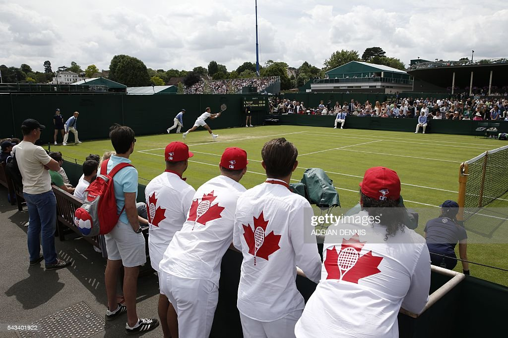 Canada's Vasek Pospisil returns against Spain's Albert Ramos-Vinolas during their men's singles first round match on the second day of the 2016 Wimbledon Championships at The All England Lawn Tennis Club in Wimbledon, southwest London, on June 28, 2016. / AFP / ADRIAN