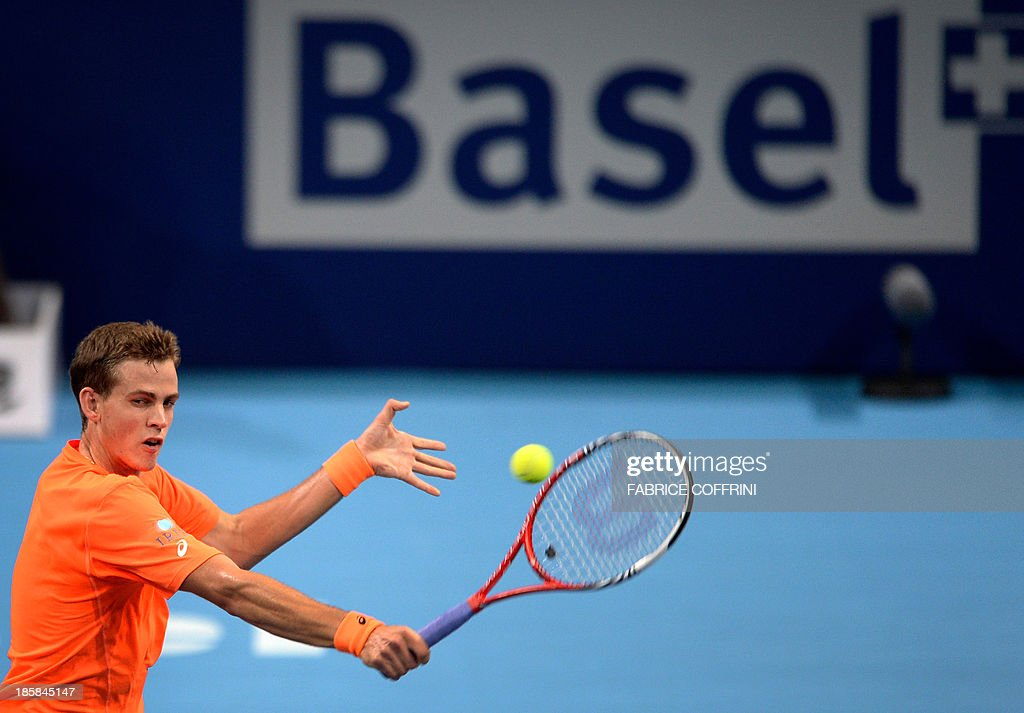 Canada's Vasek Pospisil returns the ball to Croatia's Ivan Dodig during their quarter-final tennis match at the Swiss Indoors ATP tournament in Basel on October 25, 2013.