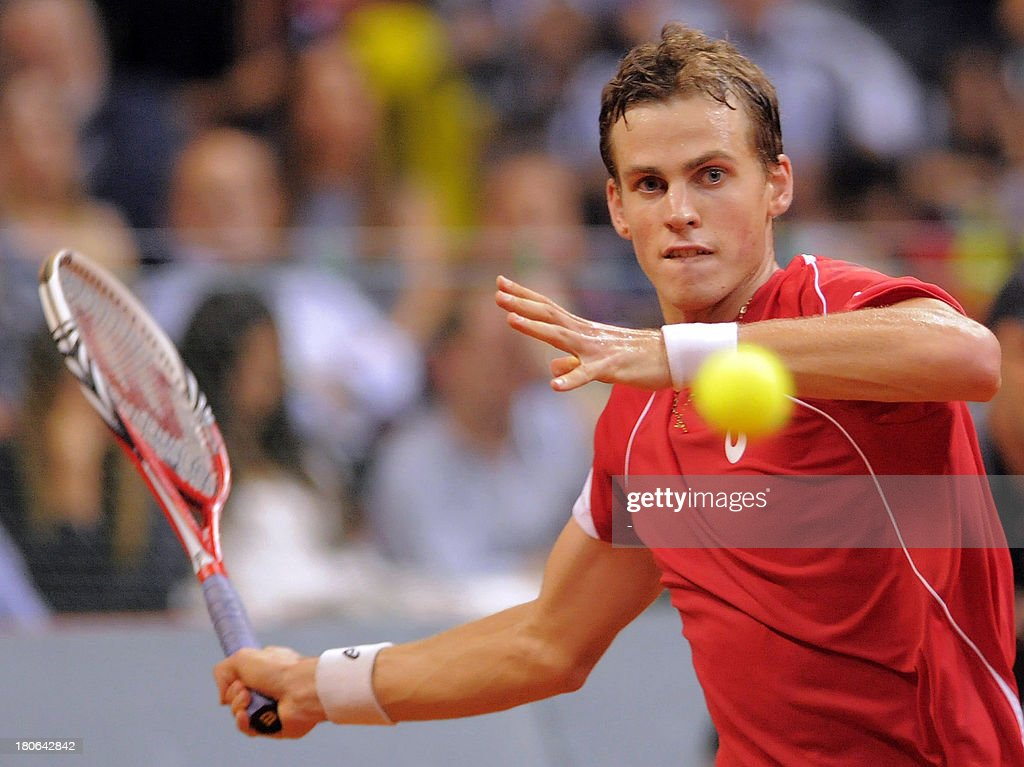 Canada's Vasek Pospisil returns the ball to Serbia's Janko Tipsarevic in the Davis Cup semi-final match between Serbia and Canada at the Belgrade Arena on September 15, 2013. Serbia, the 2010 champions, won and will host the November 15-17 final against the Czechs who defeated Argentina 3-2 in their semi-final in Prague.