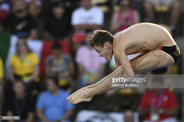 Canada's Vincent Riendeau takes part in the Men's 10m Platform Preliminary during the diving event at the Rio 2016 Olympic Games at the Maria Lenk...