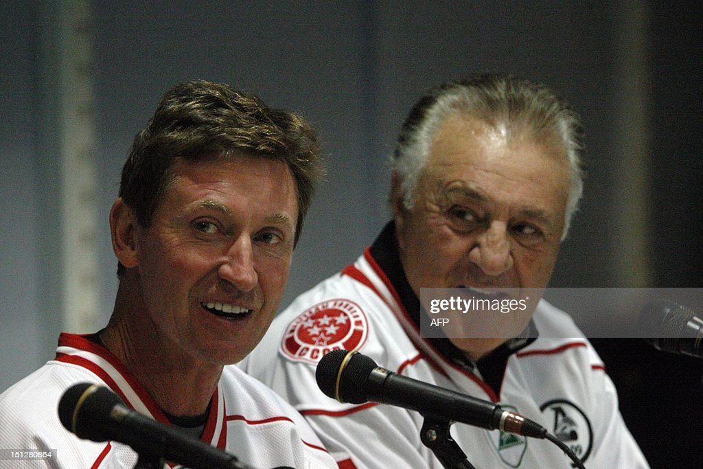 Canada's Wayne Gretzky (L) and Phil Esposito smile during a press conference before a Legends Jubilee Games 2012 hockey match between teams Legend of Canada and Legend of USSR in St. Petersburg, Russia, on September 5, 2012.