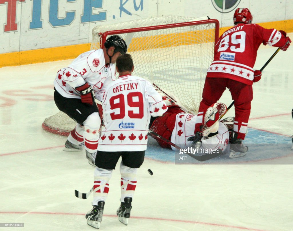 Canada's Wayne Gretzky (front) is in action on during a Legends Jubilee Games 2012 hockey match between teams Legend of Canada and Legend of USSR in St. Petersburg, Russia, on September 5, 2012.