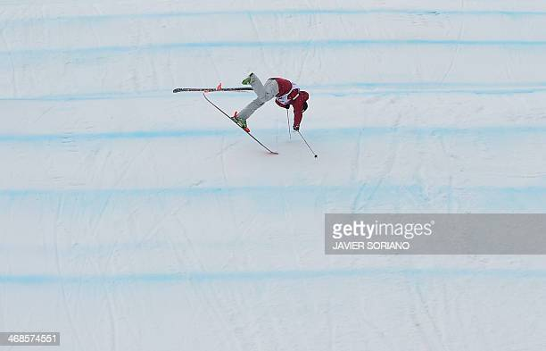 Canada's Yuki Tsubota crashes at the Women's Freestyle Skiing Slopestyle finals at the Rosa Khutor Extreme Park during the Sochi Winter Olympics on...