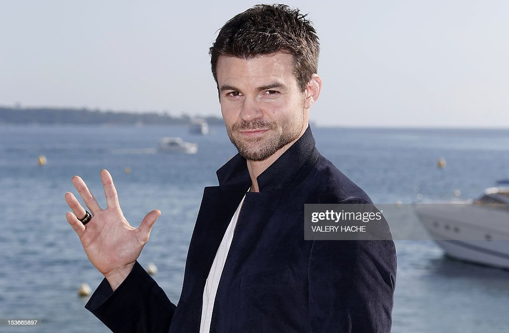 Canadian actor Daniel Gillies poses during a photocall for the TV show 'Saving Hope' as part of the Mipcom international audiovisual trade show at the Palais des Festivals, in Cannes, southeastern France, on October 8, 2012.