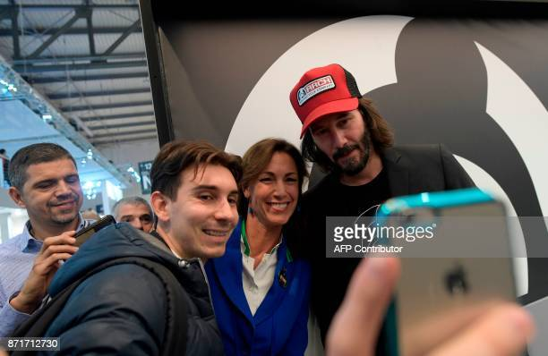 Canadian actor Keanu Reeves poses for a 'selfie' with visitors of the Arch Motorcycles stand during the 2017 Milano Moto Show on November 8 2017 in...