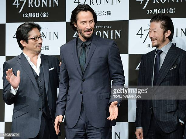 Canadian actor Keanu Reeves shares a light moment with Japanese actors Hiroyuki Sanada and Tadanobu Asano during a photo session at a press...