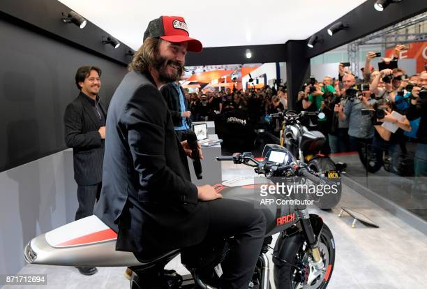 Canadian actor Keanu Reeves speaks next to US producer Gard Hollinger during the presentation of the new motorbike Arch 1s during the 2017 Milano...