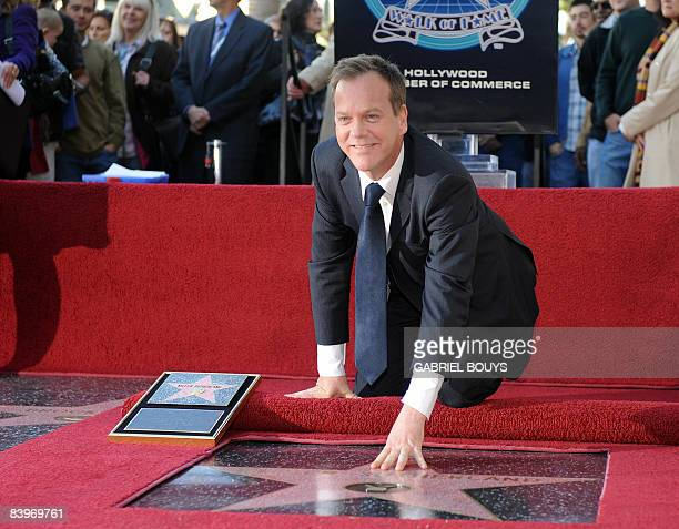 Canadian actor Kiefer Sutherland poses on his star after being honored with the 2377th Star on the Hollywood Walk of Fame December 9 2008 in...