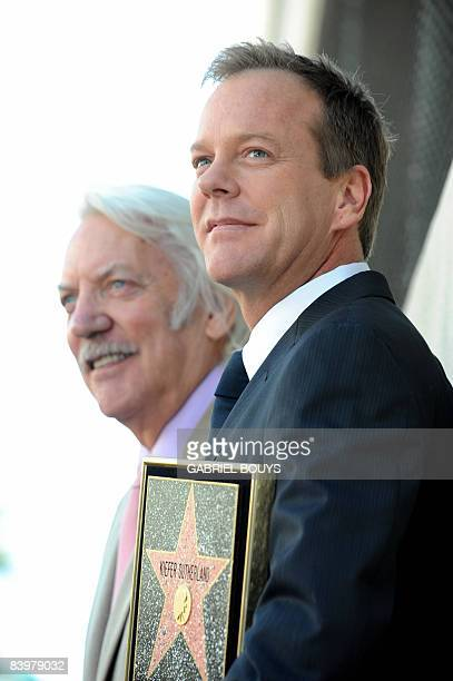 Canadian actor Kiefer Sutherland poses with his father actor Donald Sutherland after being honored with the 2377th Star on the Hollywood Walk of Fame...
