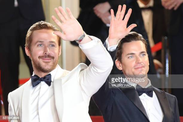 TOPSHOT Canadian actor Ryan Gosling and US actor Matt Bomer wave as they arrive on May 15 2016 for the screening of the film 'The Nice Guys' at the...