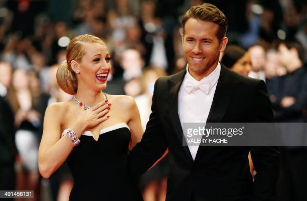 Canadian actor Ryan Reynolds and his wife US actress Blake Lively pose as they arrive for the screening of the film 'Captives' at the 67th edition of...