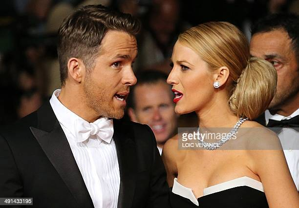 Canadian actor Ryan Reynolds and his wife US actress Blake Lively arrive for the screening of the film 'Captives' at the 67th edition of the Cannes...