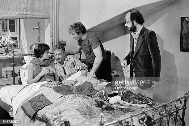 Canadian actress and singer Carole Laure French actors Michel Serrault and Gerard Depardieu with director and screenwriter Bertrand Blier on the set...