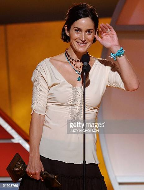 Canadian actress CarrieAnne Moss waves to her mother in Canada as she accepts her award for Best Supporting Actress for his role in 'Memento' at the...