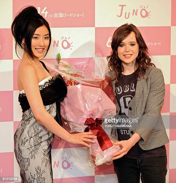 Canadian actress Ellen Page receives a bouquet of flowers from Japanese actress Satomi Ishihara during a photo session after a press conference to...