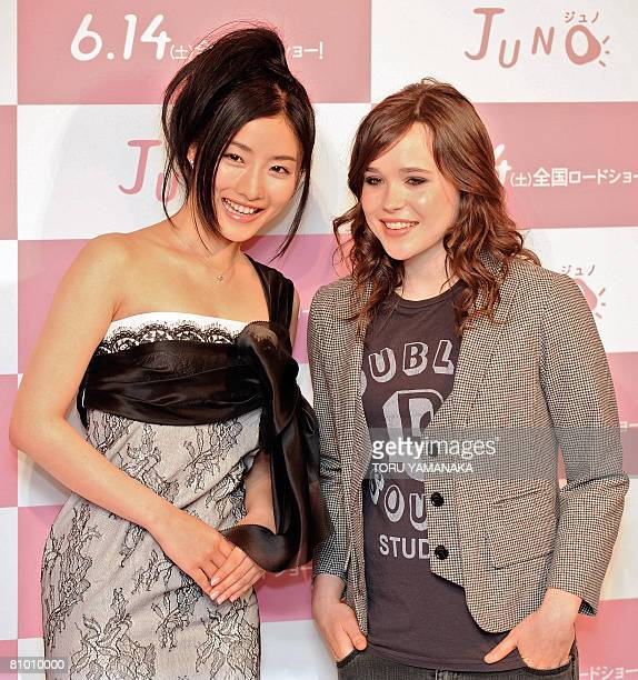 Canadian actress Ellen Page shares a light moment with Japanese actress Satomi Ishihara during a photo session after a press conference to promote...