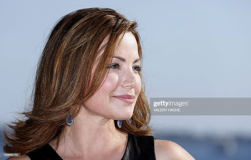 Canadian actress Erica Durance poses during a photocall for the TV show 'Saving Hope' as part of the Mipcom international audiovisual trade show at the Palais des Festivals, in Cannes, southeastern France, on October 8, 2012. AFP PHOTO / VALERY HACHE