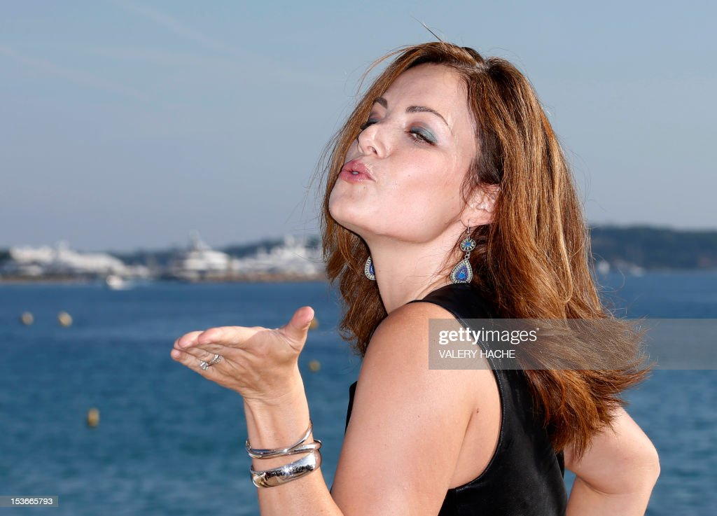 Canadian actress Erica Durance poses during a photocall for the TV show 'Saving Hope' as part of the Mipcom international audiovisual trade show at the Palais des Festivals, in Cannes, southeastern France, on October 8, 2012.